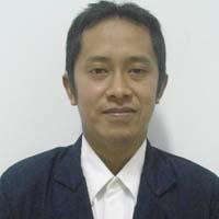 Dr. Romaidi, M.Si
